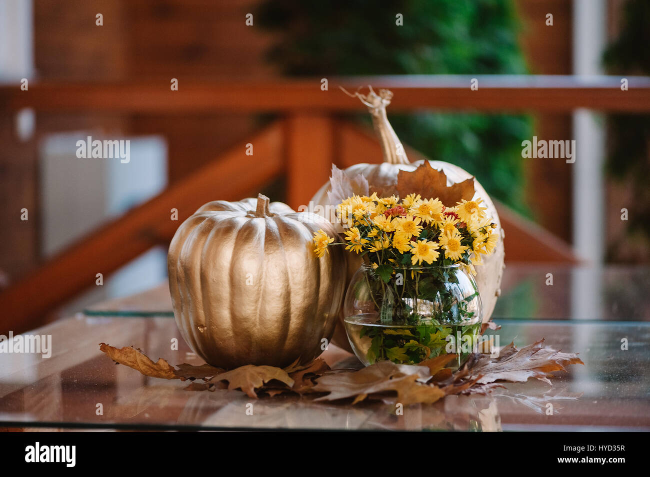 Golden pumpkin decoration with the yellow flowers Stock Photo ...