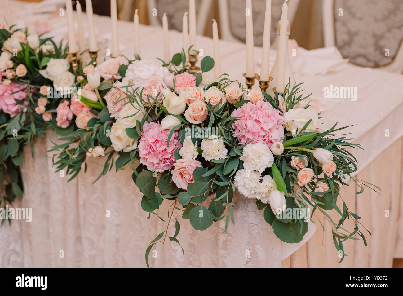 Wedding table decoration with roses carnations and candles in the stock photo royalty free - Deco table rose ...