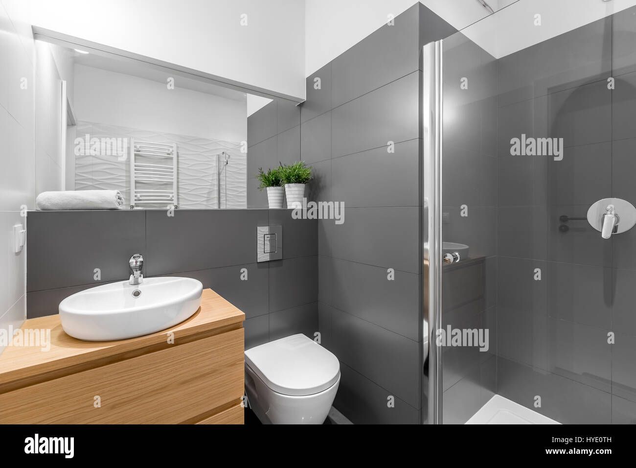 modern grey bathroom with shower wooden cabinet round white basin stock photo 137376305 alamy. Black Bedroom Furniture Sets. Home Design Ideas