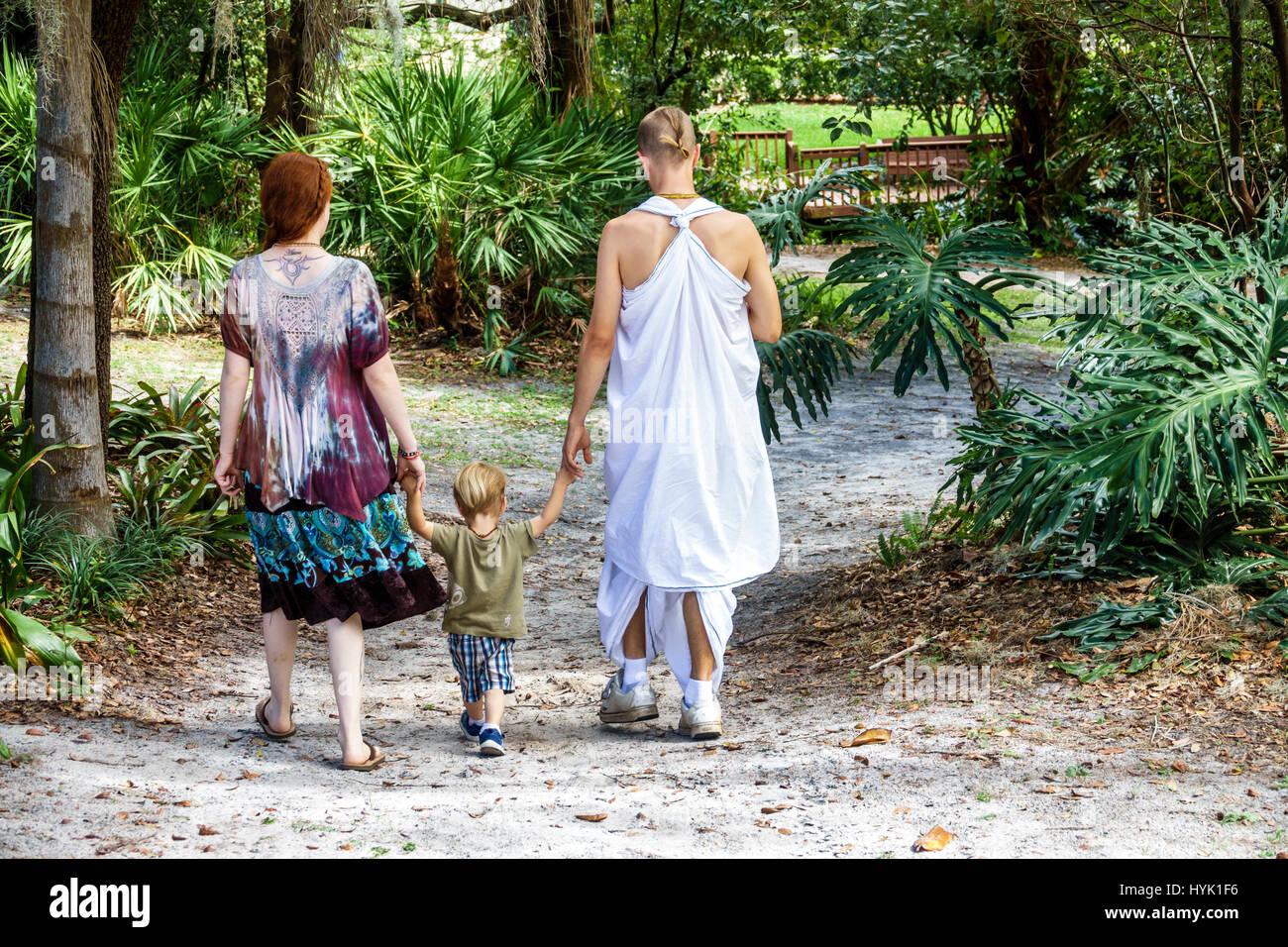 Winter Park Orlando Florida Mead Botanical Garden Nature Pathway Vegetation  Woman Man Boy Toddler Family Monk Robe Religion Walking Hare Krishnas Kris