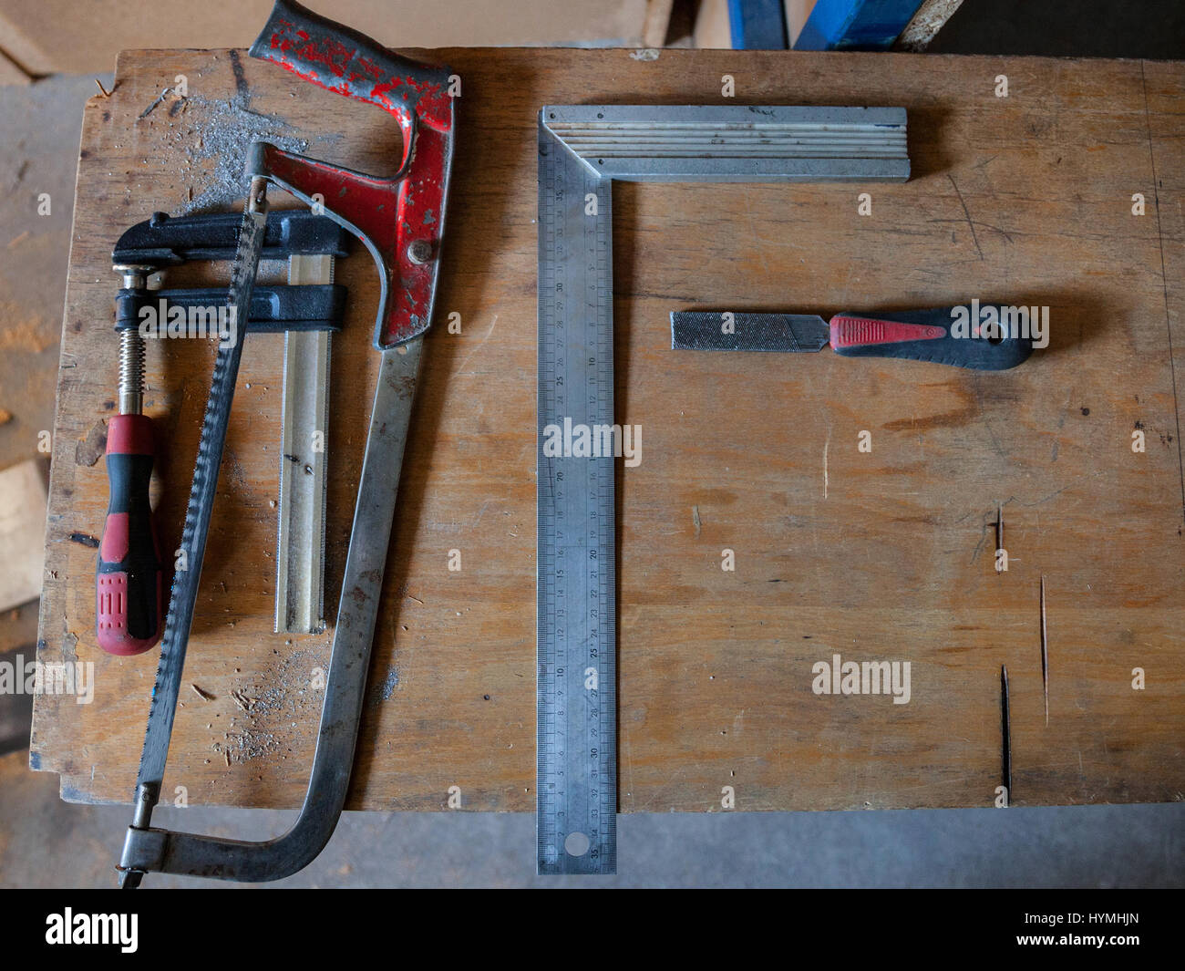 Woodworking tools t square clamps saw and a file put on a woodworking tools t square clamps saw and a file put on a wooden workbench picture of some tools a t square some clamps a saw and a file put jeuxipadfo Choice Image