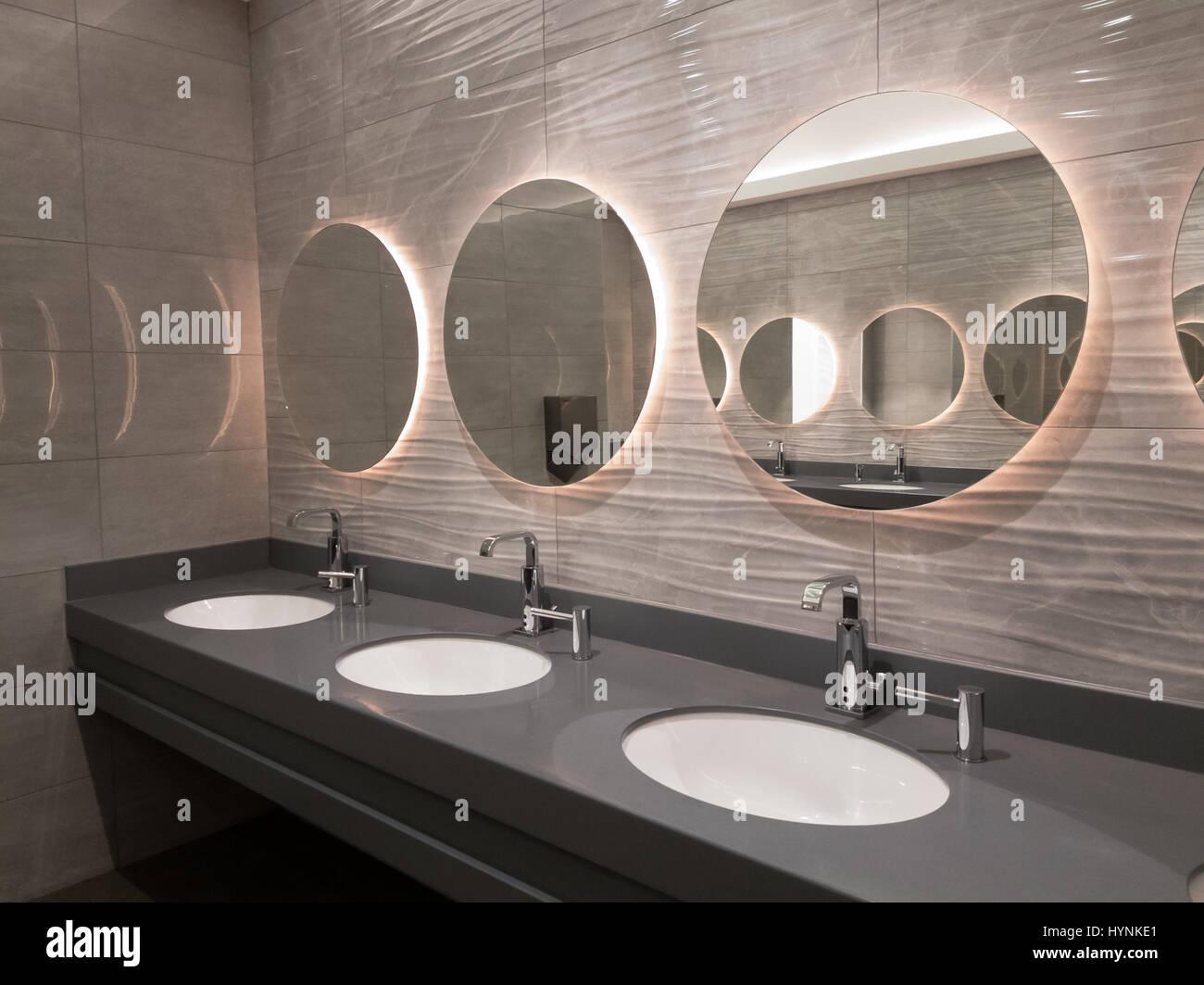 Modern public washroom interior Stock Photo, Royalty Free Image ...