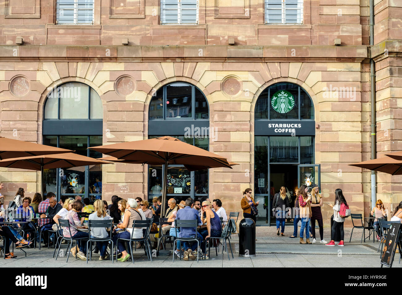 starbucks coffee terrace people aubette building place kl ber stock photo royalty free image. Black Bedroom Furniture Sets. Home Design Ideas