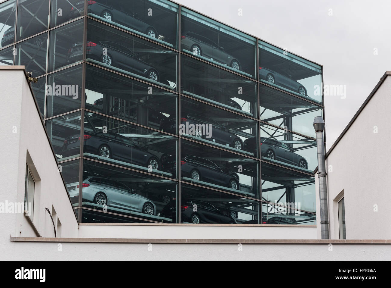 Motor cars for sale at car showroom garage stacked in for 6 car garage for sale