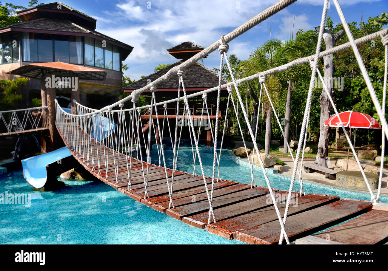 Swimming Pool Bridge Build : Small rope hanging bridge across the swimming pool in