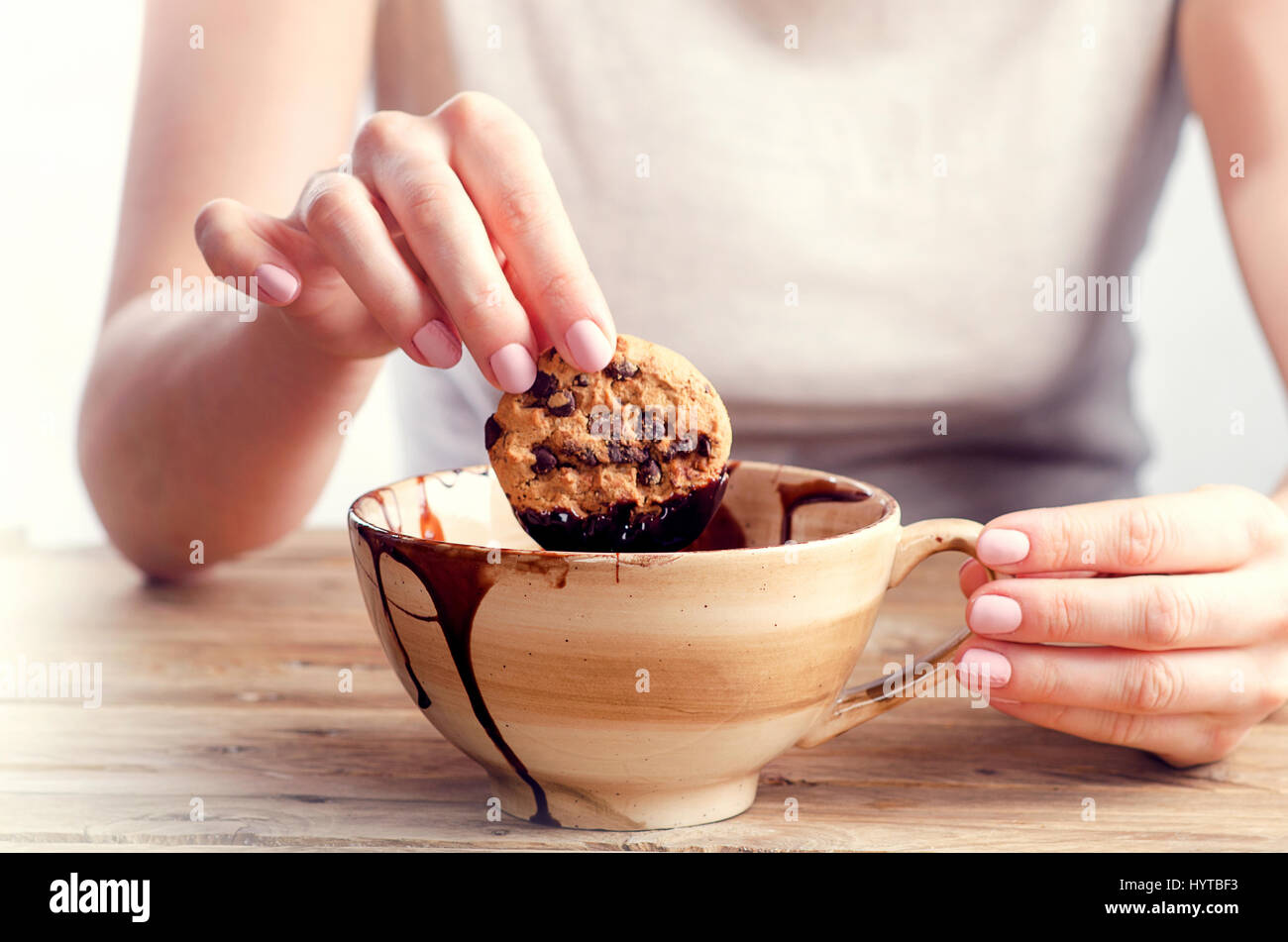 Woman hand dipping cookie in the melted chocolate Stock Photo ...