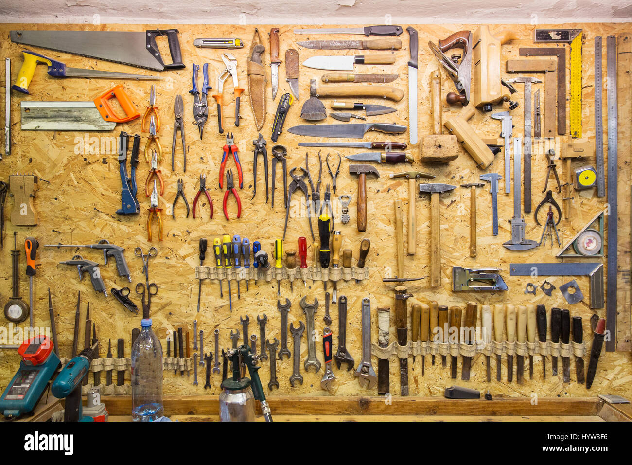 work tools hanging on wall at workshop stock photo. Black Bedroom Furniture Sets. Home Design Ideas
