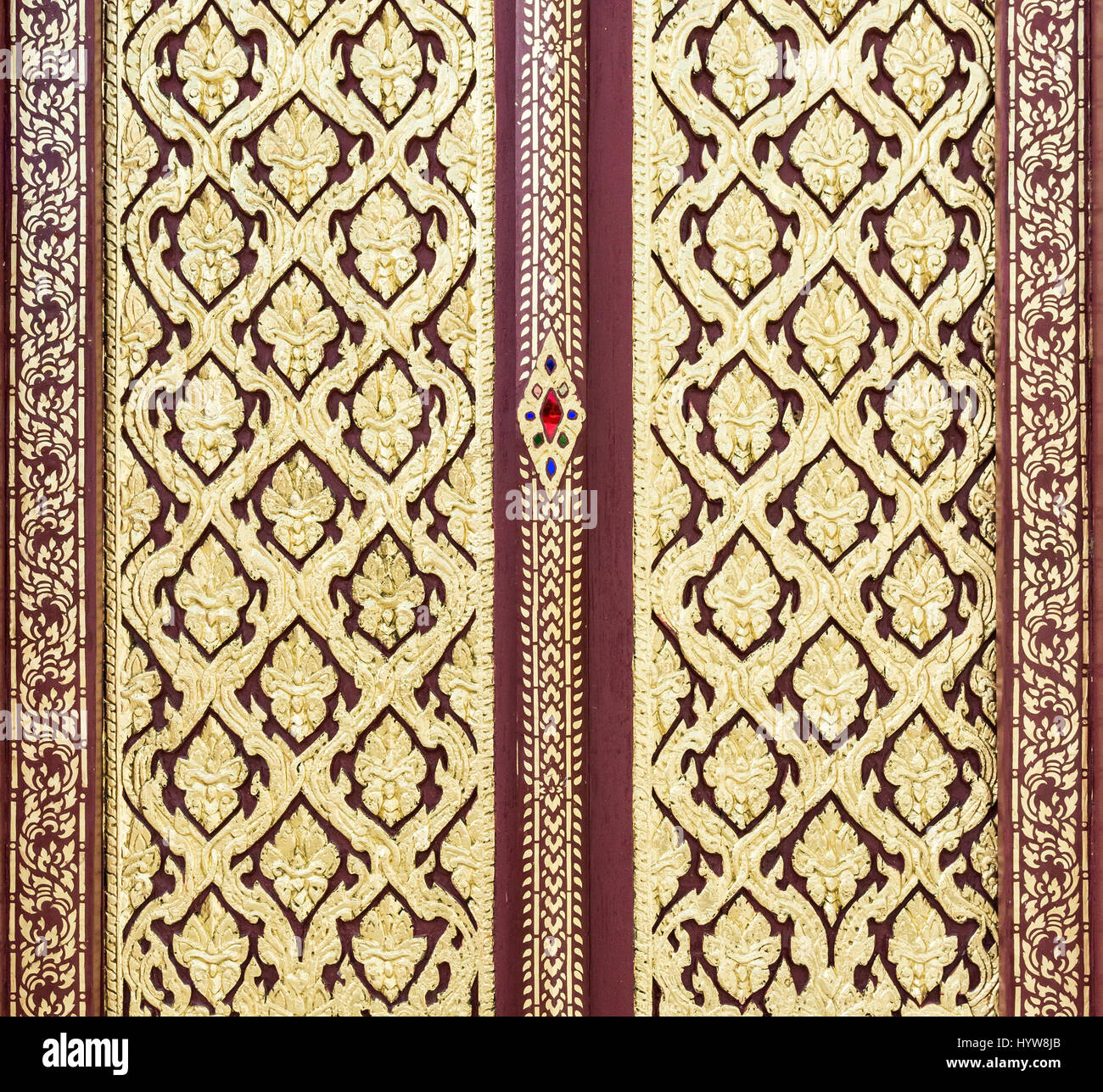 Stock Photo - Wooden carved door with the golden pattern in the traditional Thai style of the Thai temple.(Public area not required Property Release