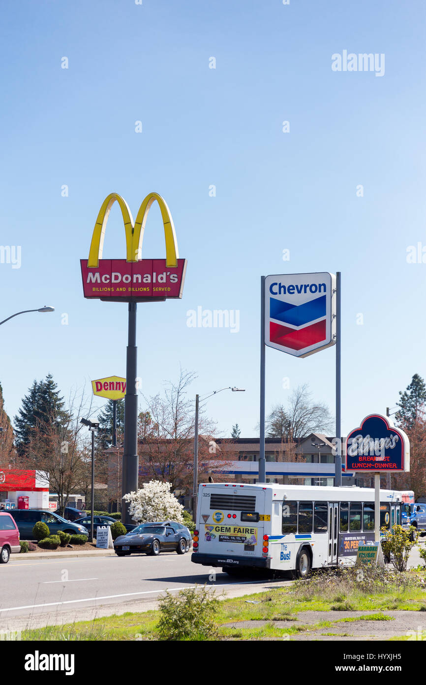 springfield or march 31 mcdonalds and chevron gas station signs directly next to each other in the gateway area of springfield oregon