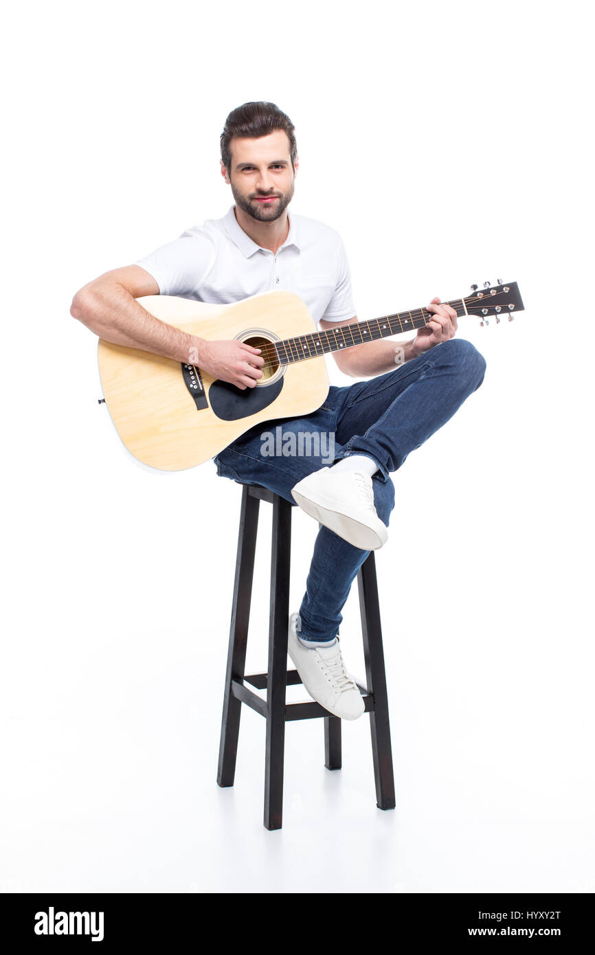 Handsome young man with guitar sitting on bar stool isolated on white  sc 1 st  Alamy & Handsome young man with guitar sitting on bar stool isolated on ... islam-shia.org