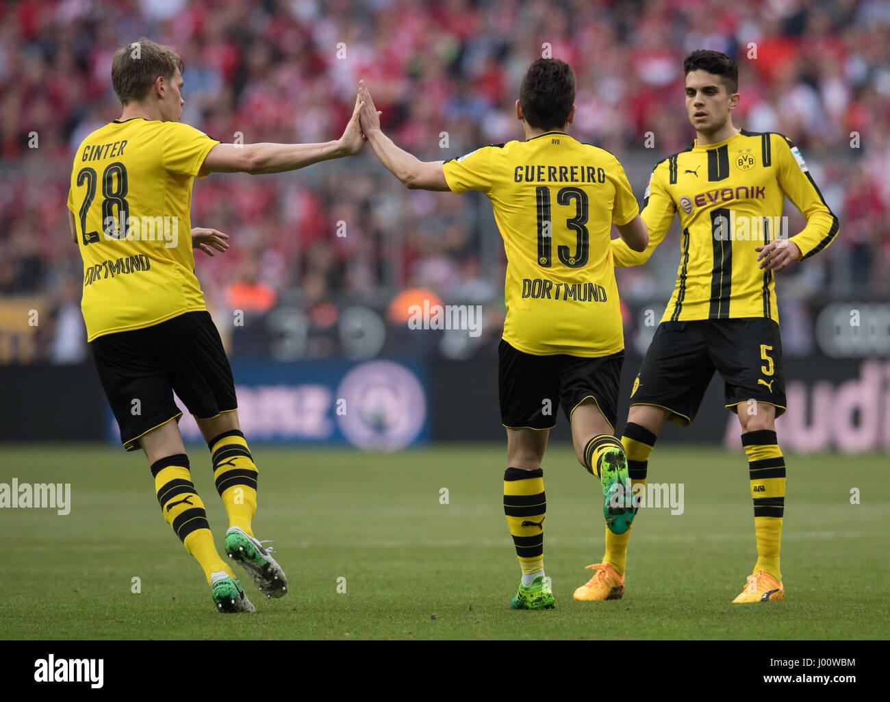 Dortmund s Matthias Ginter l r scorer Raphael Guerreiro and