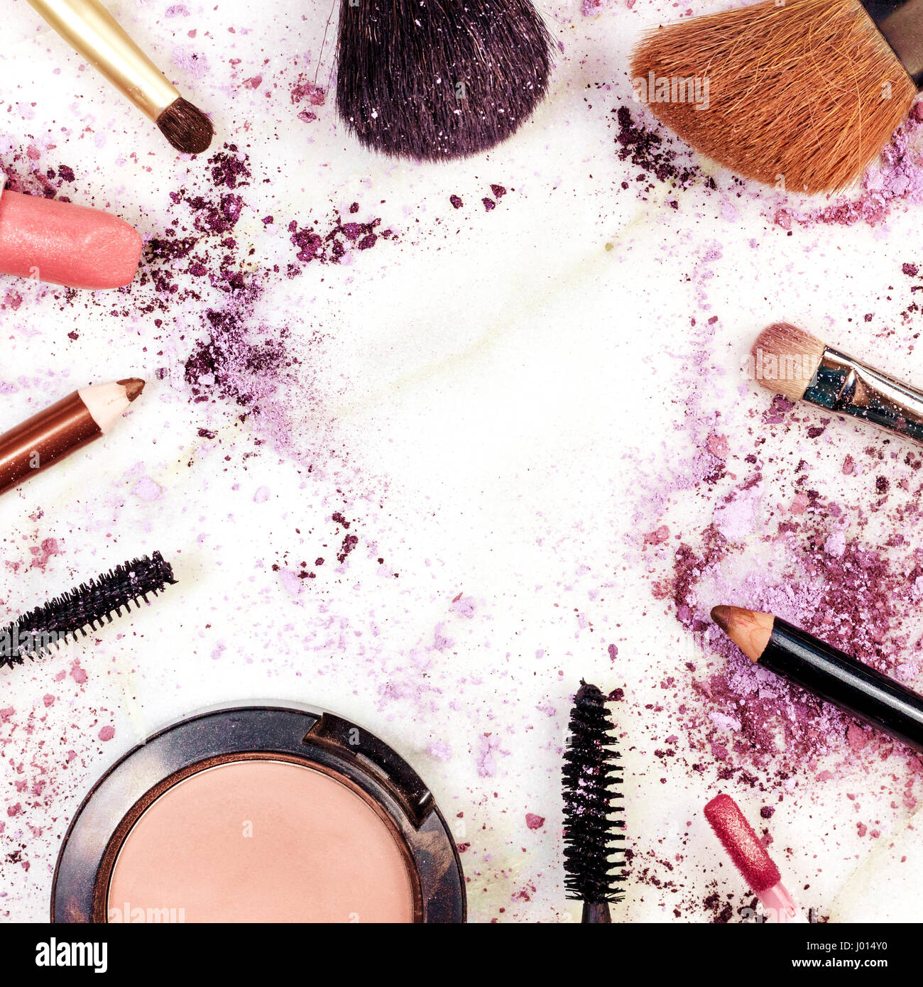 Makeup brushes, pencil, lipstick and other objects ...