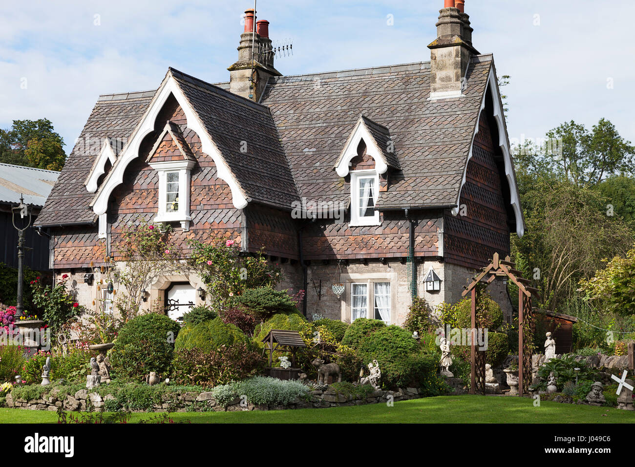 A Victorian Style House With Tiled Roof And Decorative