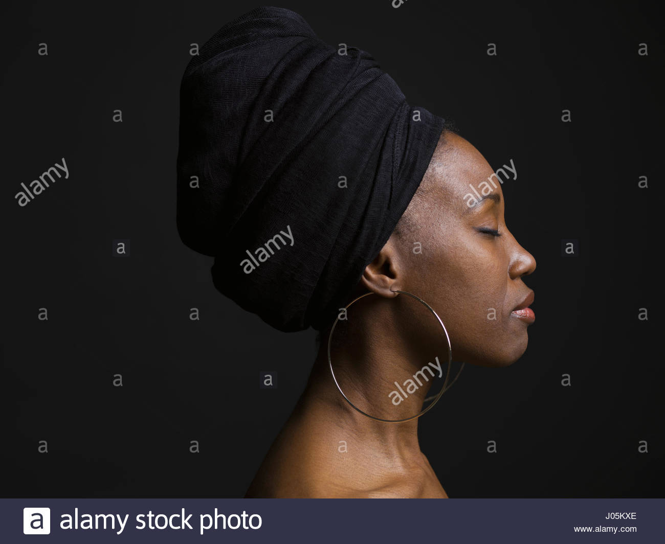 Profile portrait serene African American woman wearing ...