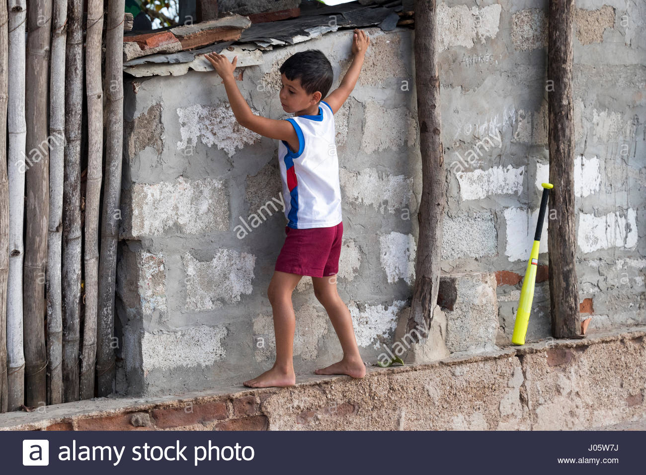 cuban children playing baseball with rag ball the sport is a