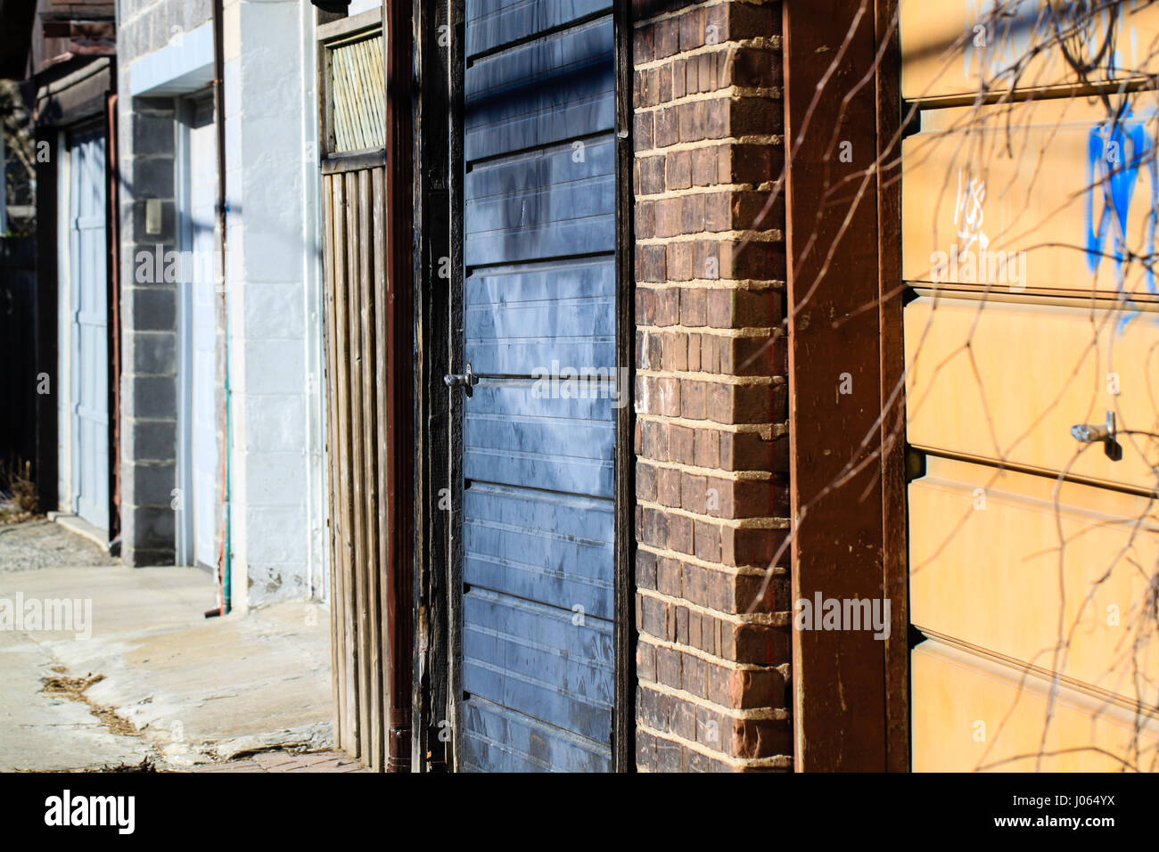 Beautiful Back Alley. Juxtaposition Of Colorful Garage Doors And Variety Of  Structures In An Alley Behind
