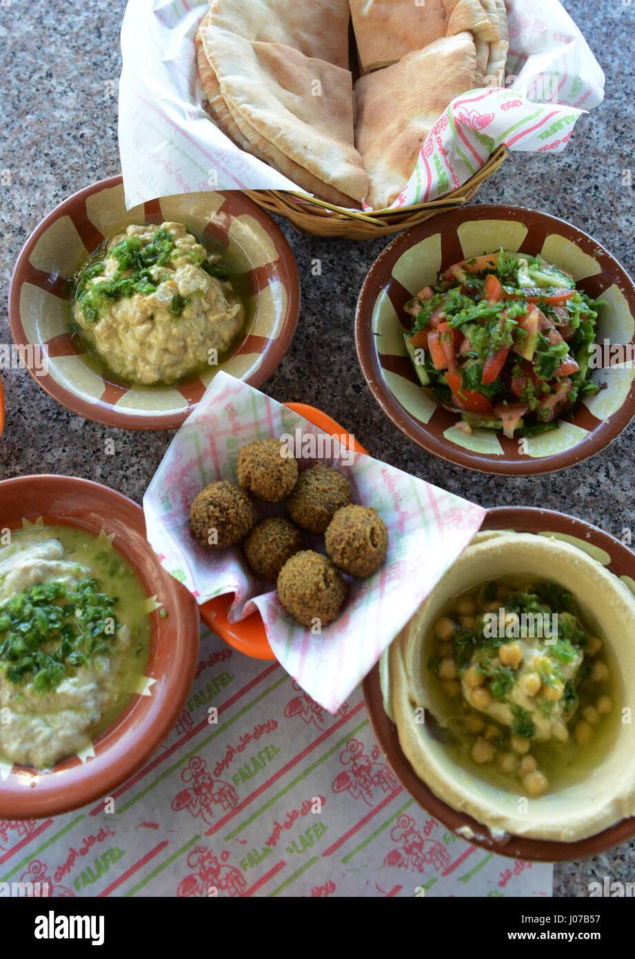 Traditional jordanian breakfast hummus falafel and pita for American cuisine presentation