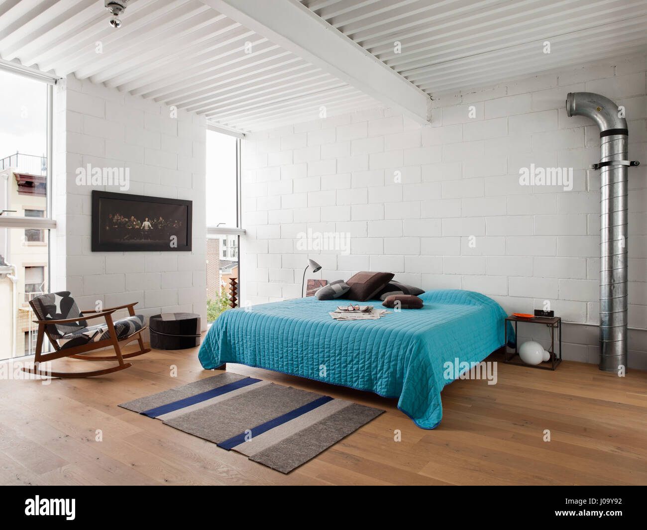 Master bedroom with exposed CMU walls white painted steel decking – Interior Wall Surface Wiring