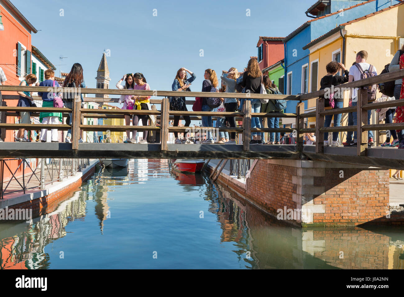 Colorful burano italy burano tourism - Burano Italy September 22 2016 Tourist Walk Along The Bridge Over Canal With Colourful Houses And Leaning Tower Burano Is An Island In The Venet