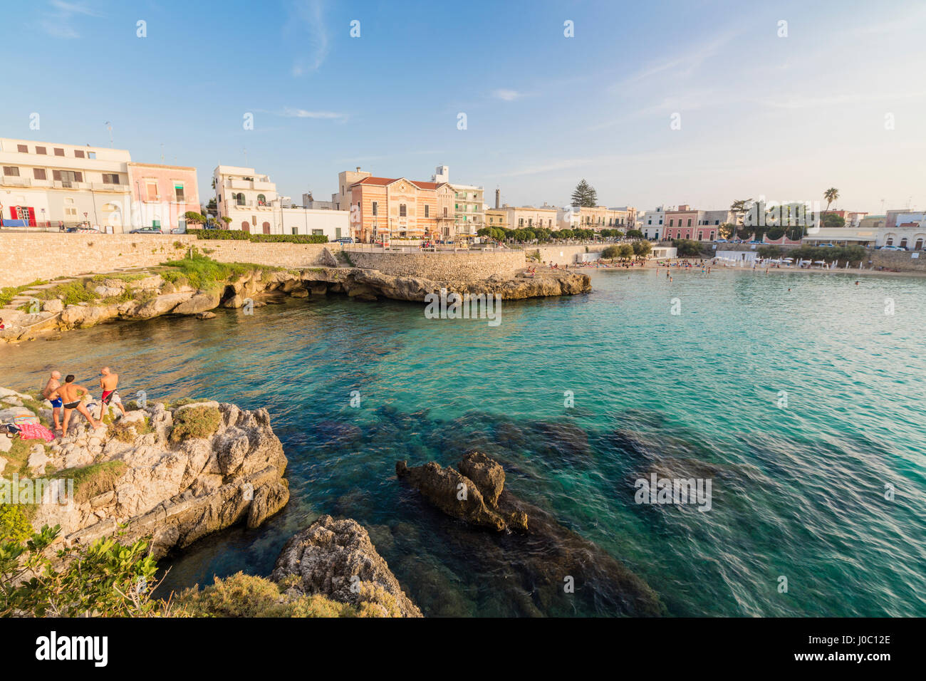 Turquoise sea and cliffs frame the fishing village of Santa Maria ...