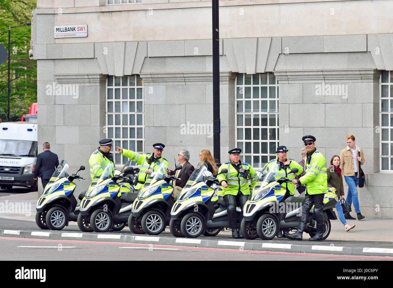 london, england, uk. metropolitan police piaggio mp3 scooters