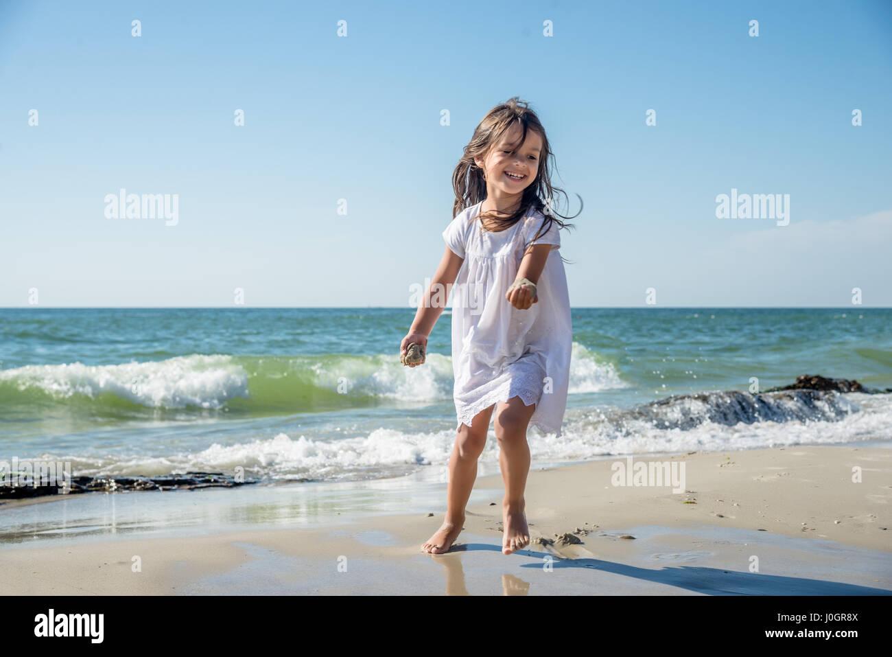 Happy little girl running on the beach Stock Photo ... Girl Running On Beach
