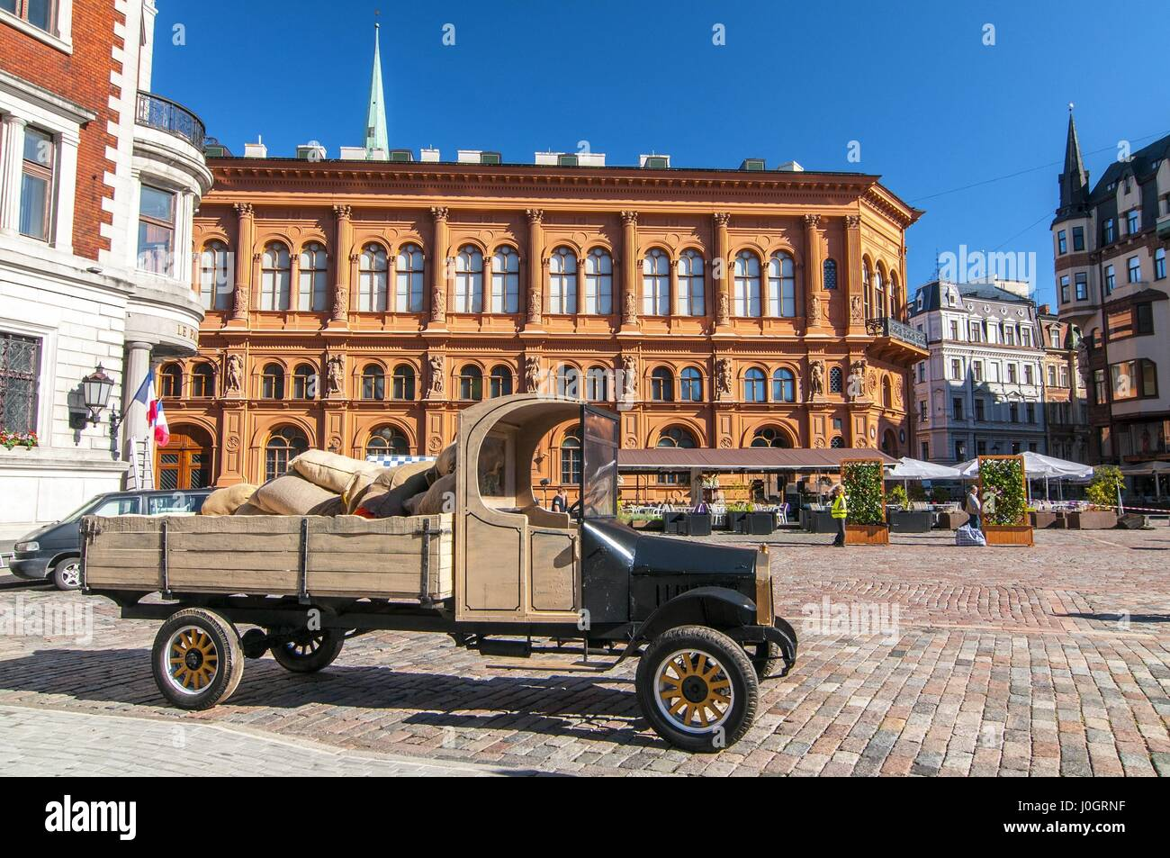 Old car in front of Art Museum Riga Bourse on Doms square ...