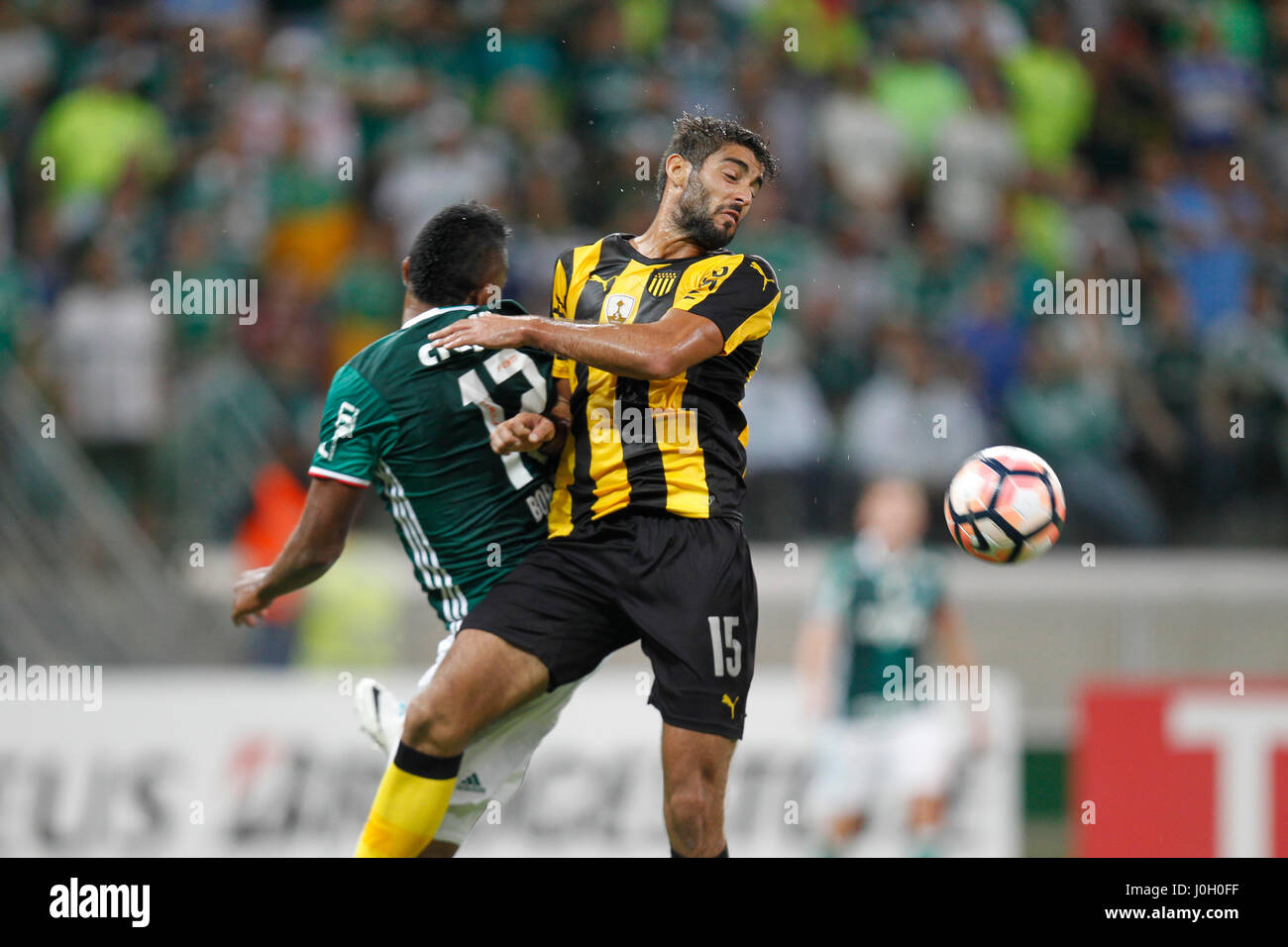 Palmeiras Miguel Borja L vies for the ball with Penarol s