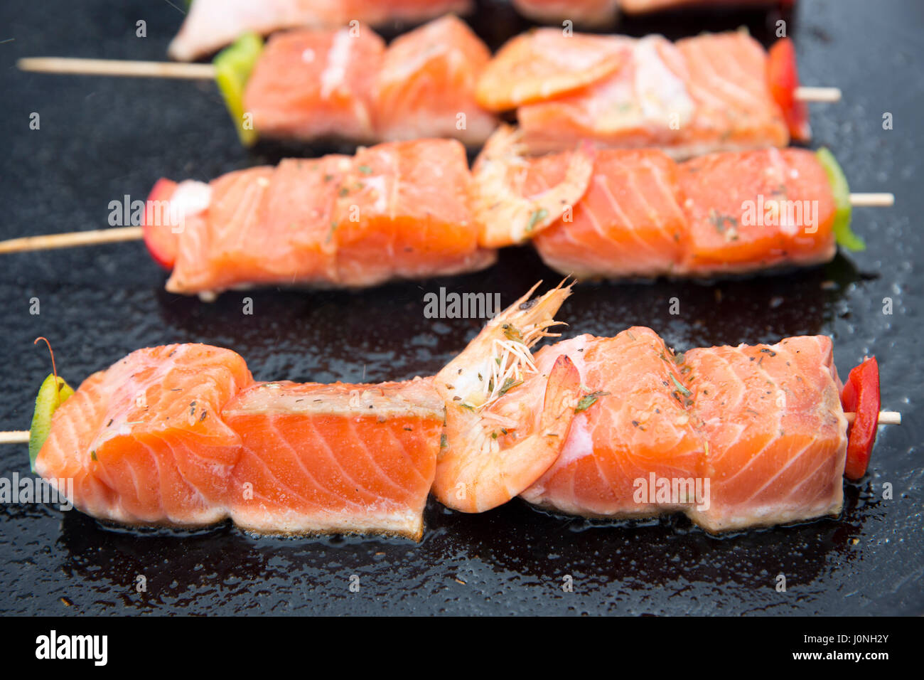 Grilled Salmon Fillets And Prawns Healthy Fast Food Cooked On Griddle For  Sale At Street Market