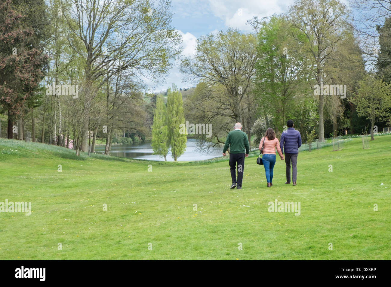 A tour guide escorting visitors around the gardens designed by