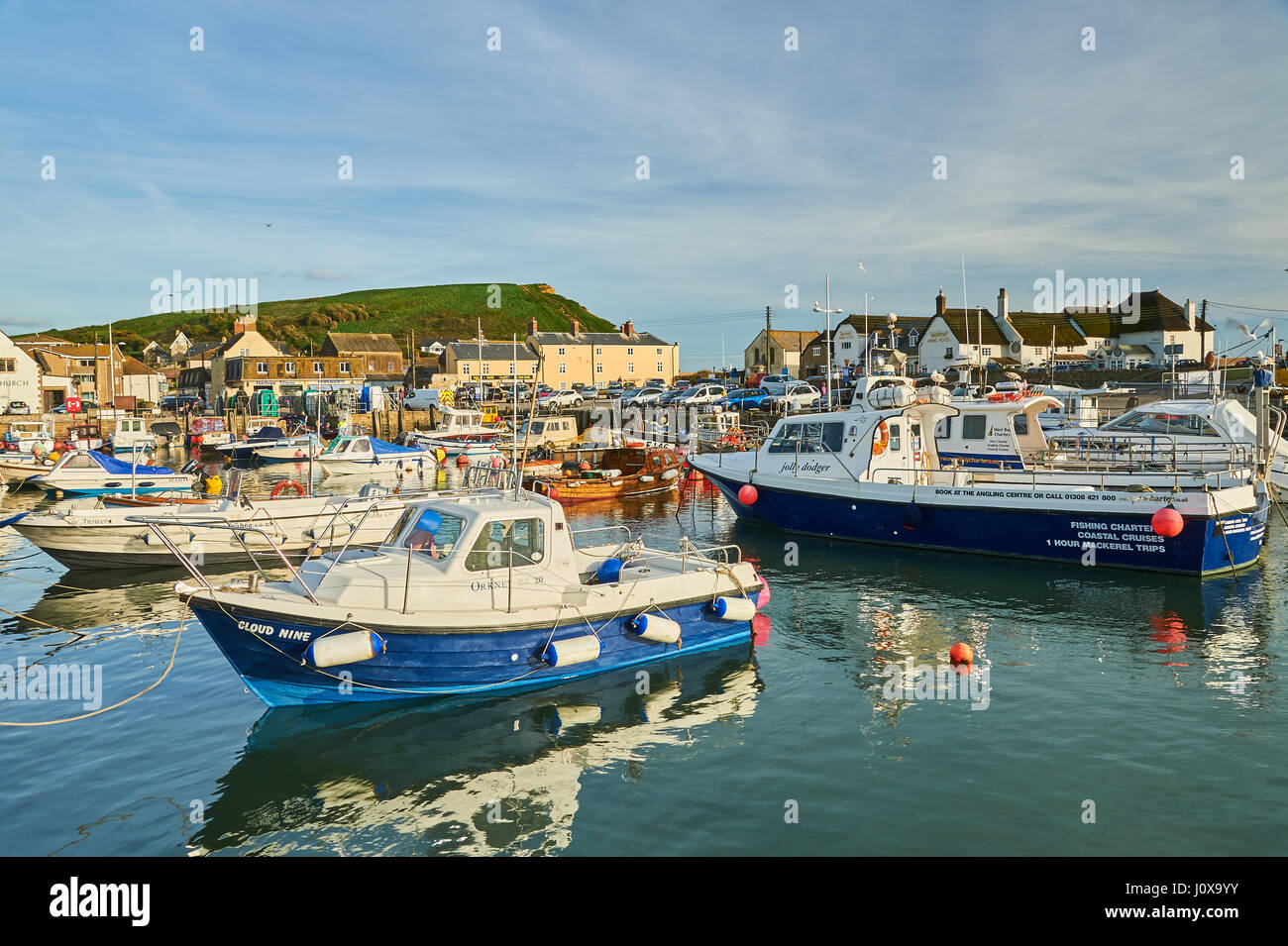 High tide fishing boats and trawlers in the small seaside town of high tide fishing boats and trawlers in the small seaside town of west bay on dorsets jurassic coast geenschuldenfo Gallery