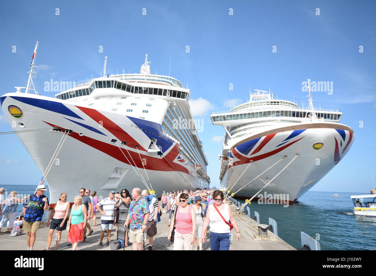 Britannia Cruise Ship And Azura Cruise Ship In Barbados Stock - Britannia cruise ship