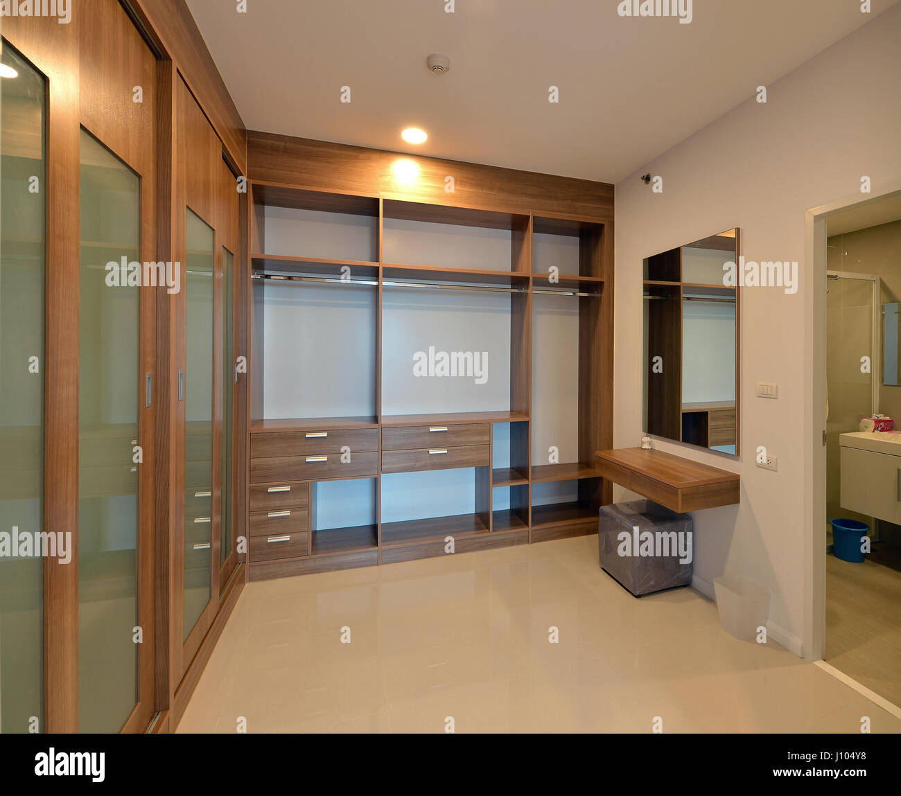 Wooden Carbinets In Dressing Room In Modern Home Interior Design - Dressing room designs in the home
