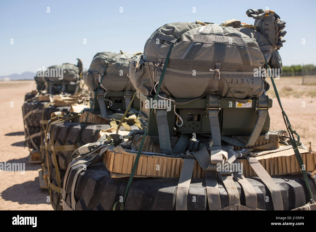 Joint Precision Airdrop Systems Are Secured To Palletized Gear And Staged  To Be Loaded On To