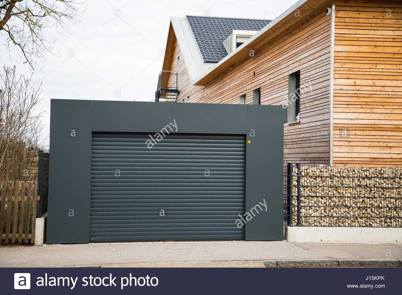 Modern garage door in black gray Stock Photo Royalty Free Image