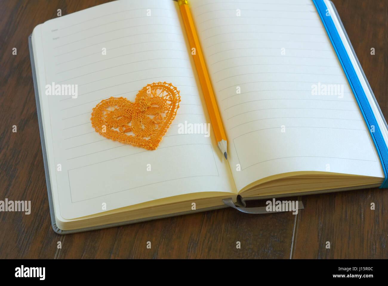 Heart symbol with pencil on open blank notebook page love message heart symbol with pencil on open blank notebook page love message romance concept lyrics loveletter book buycottarizona Gallery