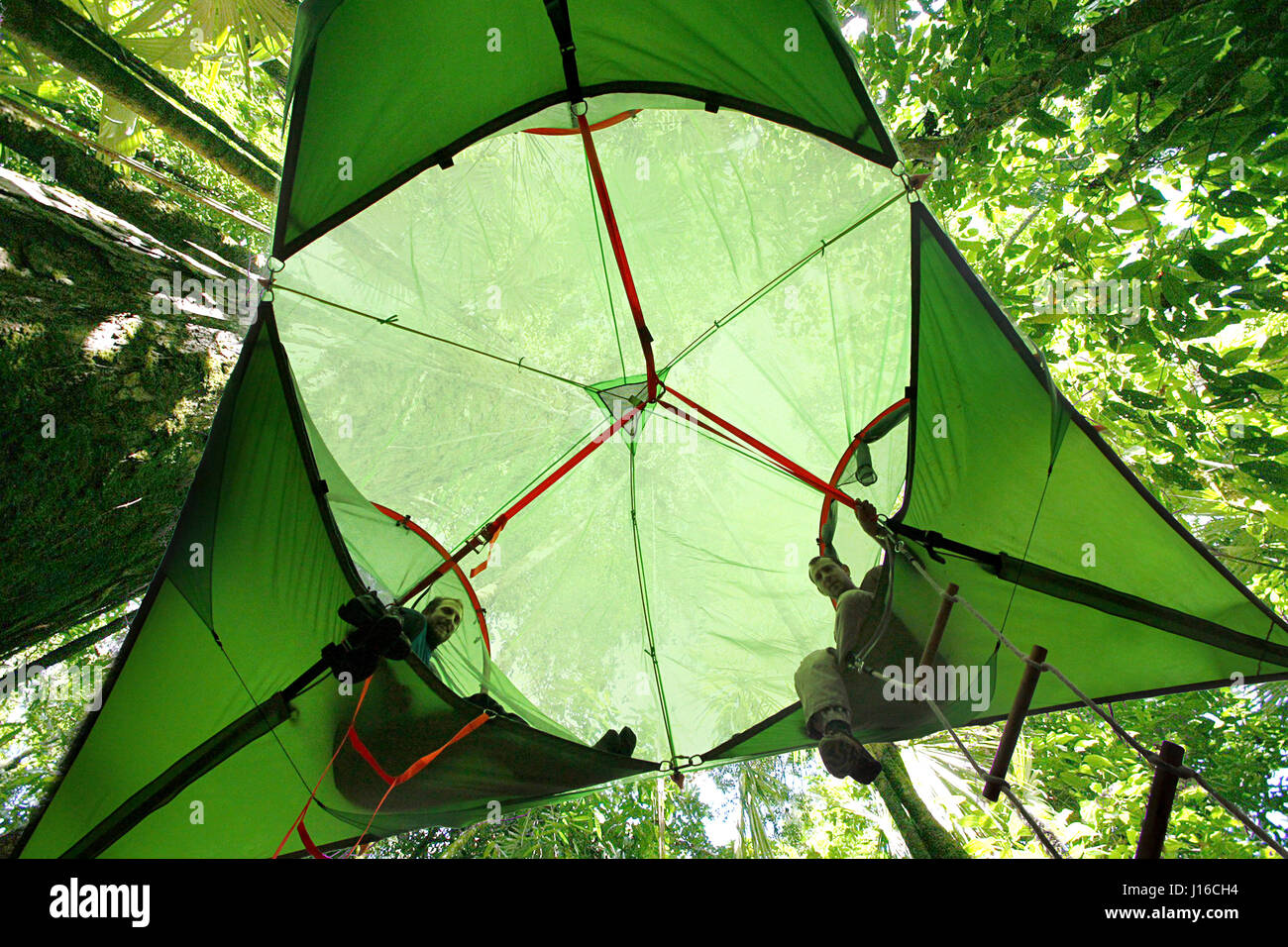 ENGLAND Friends relax on the Tensile portable treehouse. WELCOME to the tent in the & ENGLAND: Friends relax on the Tensile portable treehouse. WELCOME ...