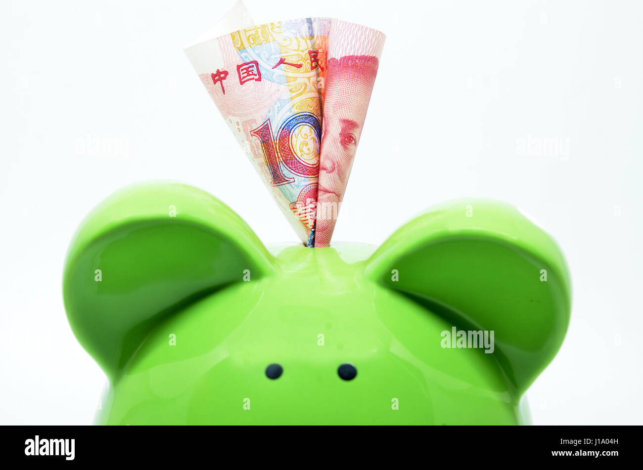 Green piggy bank with china currency rmb stock photo royalty free green piggy bank with china currency rmb buycottarizona Gallery