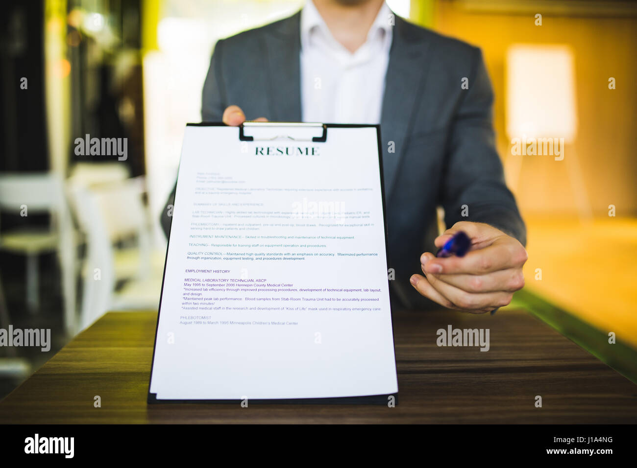 Young Businessman Submitting Resume To Employer To Review Job