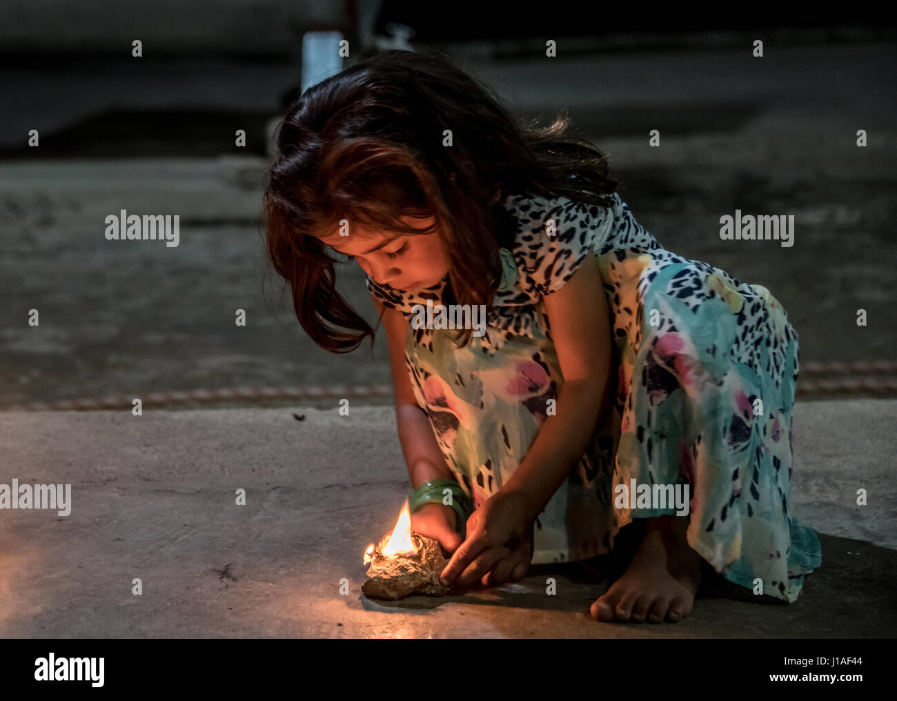 A little girl with her Sere Sal, or Yazidi New Year oil lamp in ... for Little Girl With Lamp  568zmd
