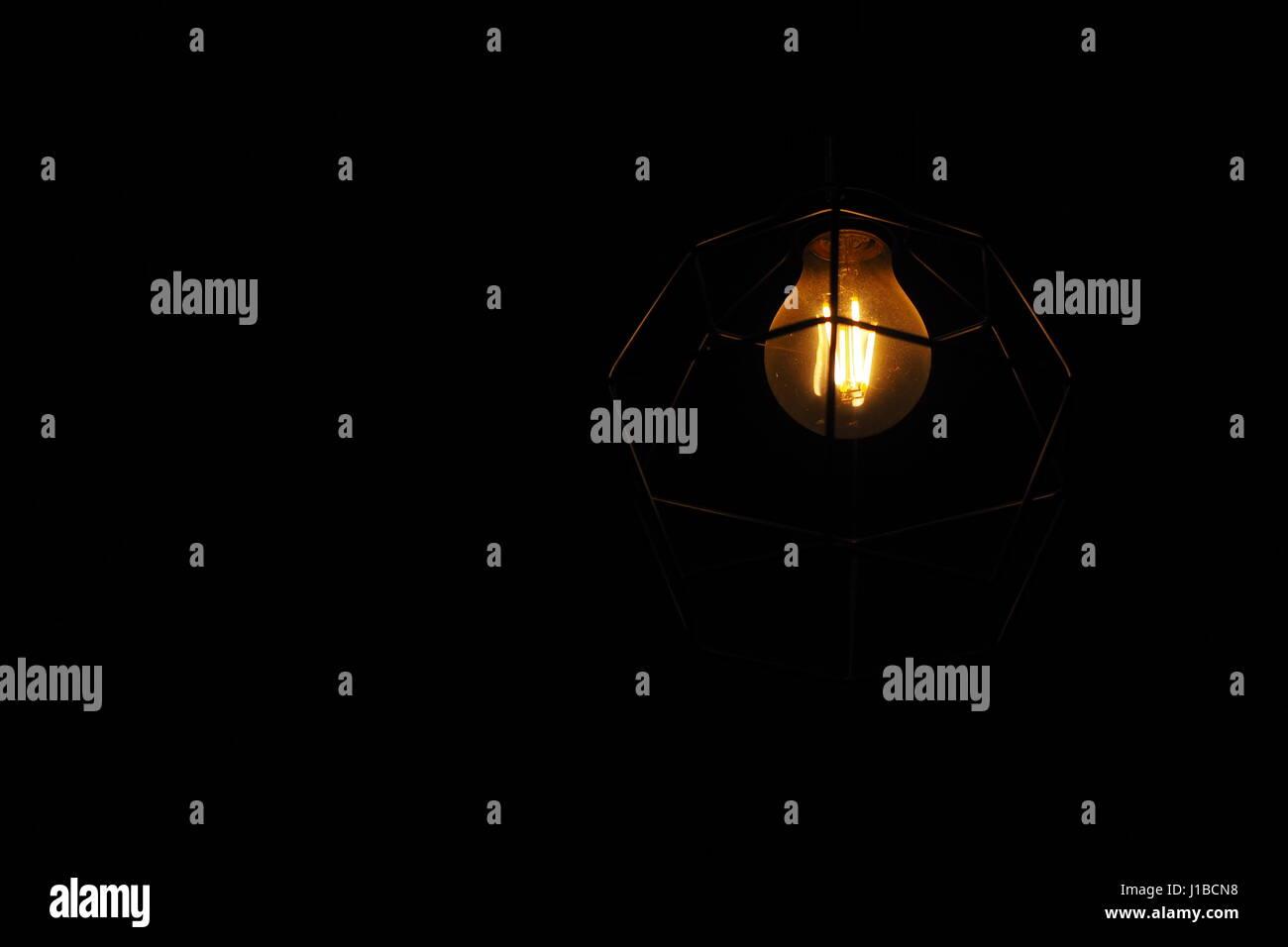 Dark room with light bulb - Isolated Light Bulb In A Dark Room