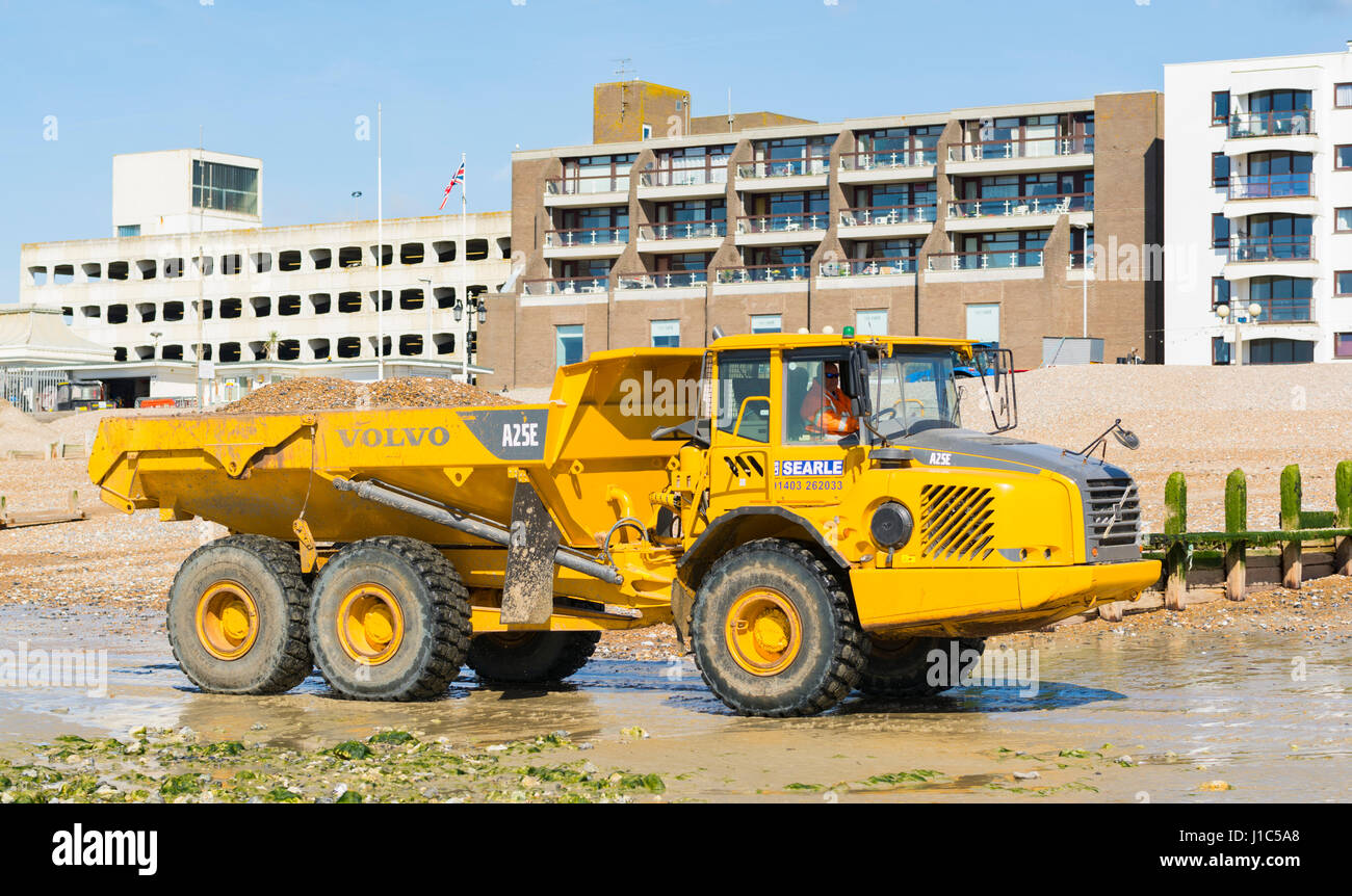 volvo dump trucks. volvo a25e articulated hauler (dump truck) moving shingle on worthing beach, worthing, dump trucks