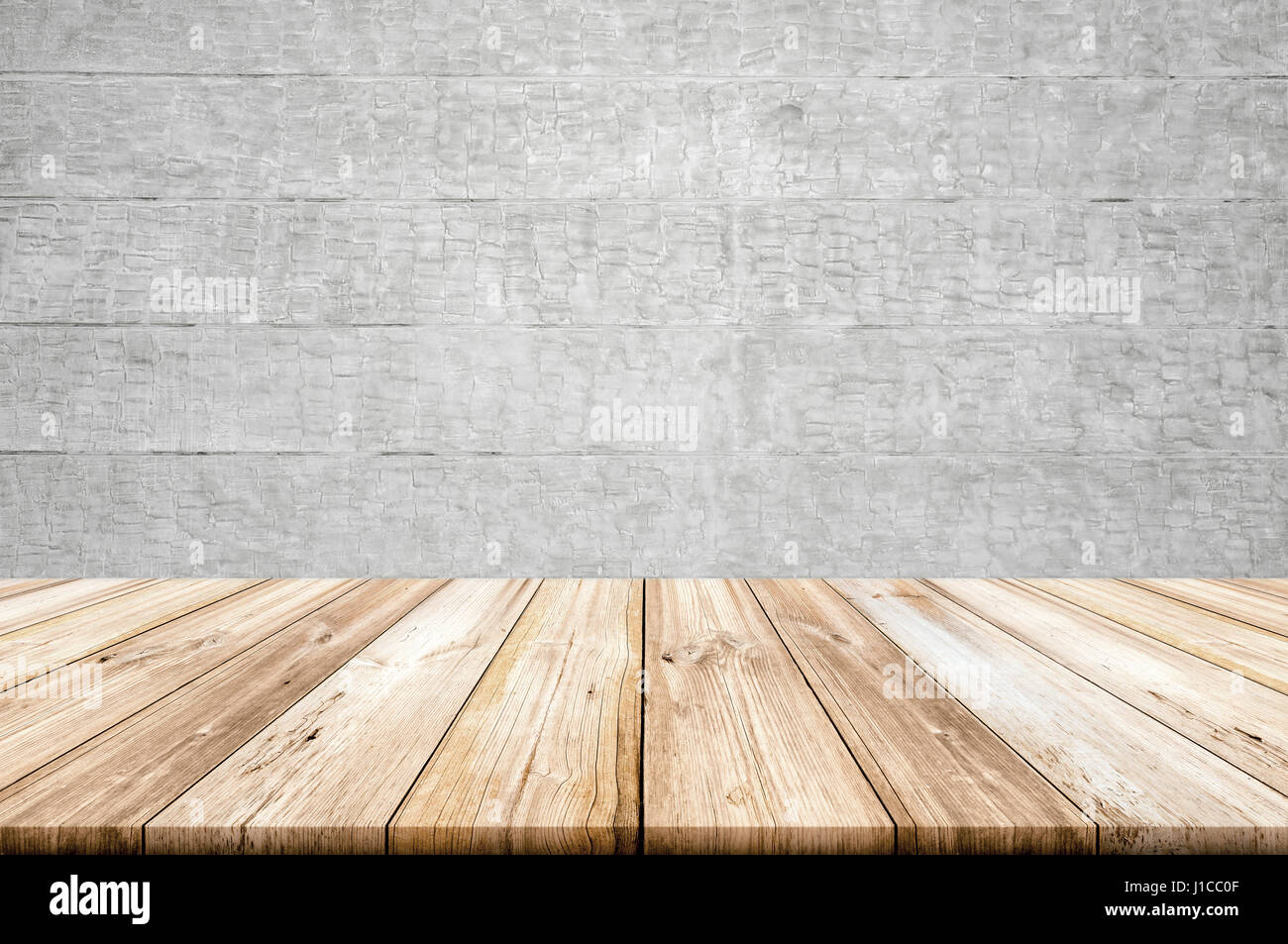empty light wood table top with concrete wall background