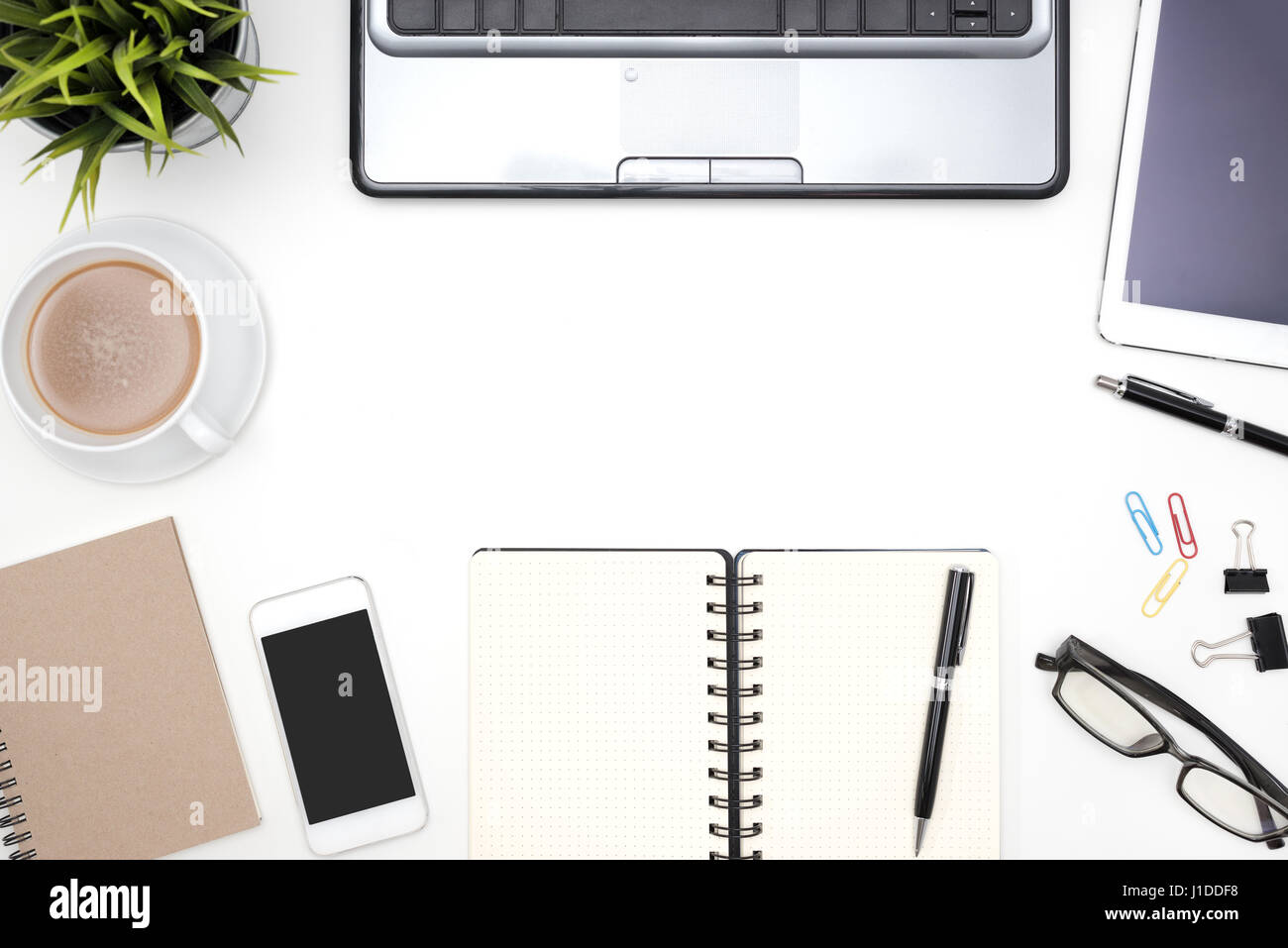 Frame Of White Office Desk Table Background With Computer, Supplies,  Notebook, Pen,