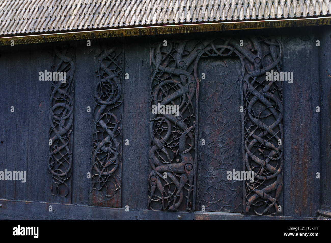 Wood carving in the old wooden church of Urnes, Norway ...