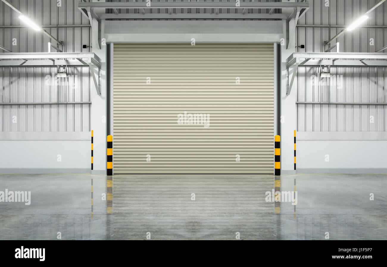 Shutter door or roller door and concrete floor inside factory shutter door or roller door and concrete floor inside factory building use for industrial background rubansaba