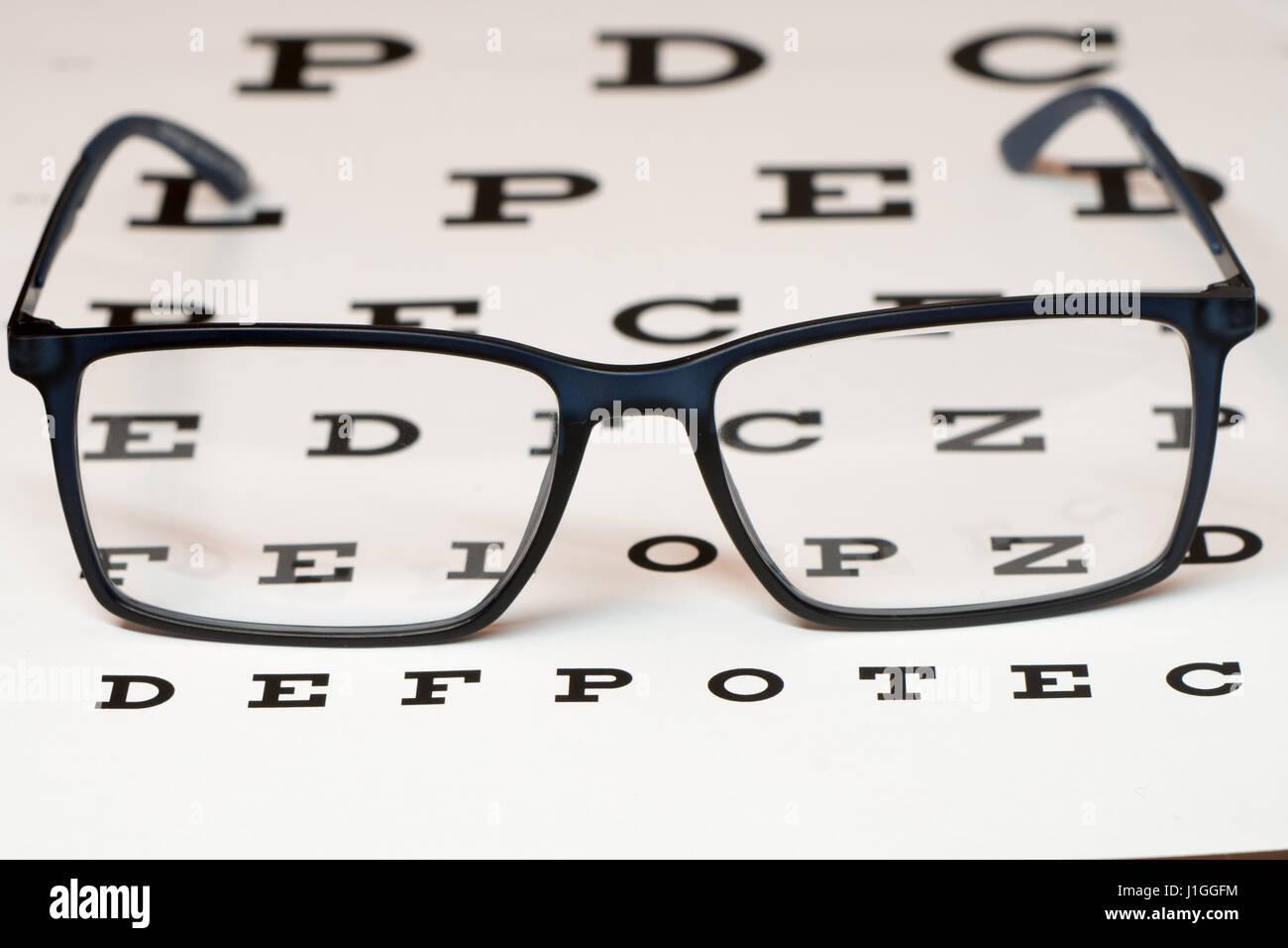 Reading black eyeglasses and eye chart close up stock photo reading black eyeglasses and eye chart close up nvjuhfo Image collections