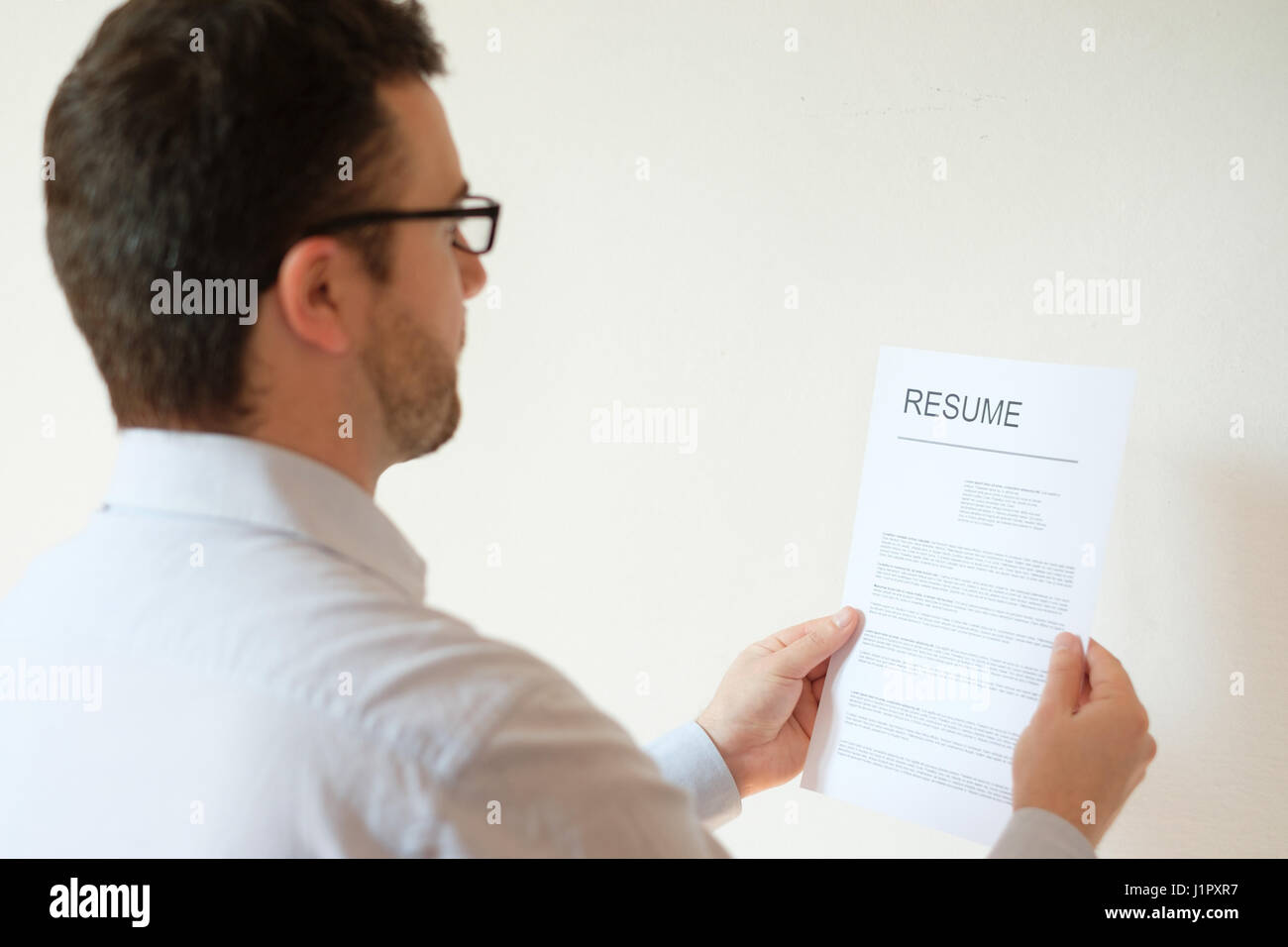 Man With Resume And Work Career Ready To Find A Job Stock Photo