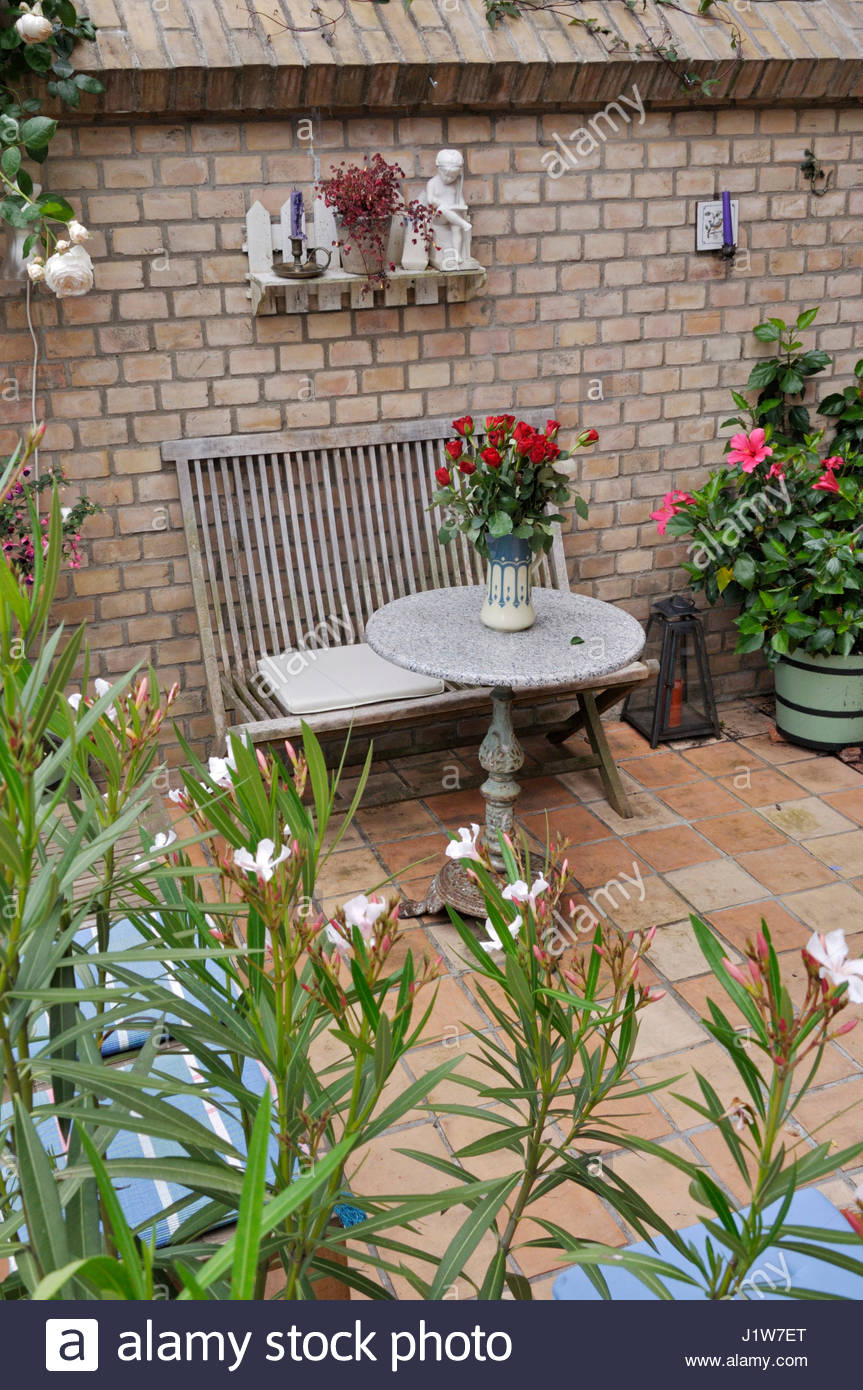 terrace of a backyard garden with seating area design jutta
