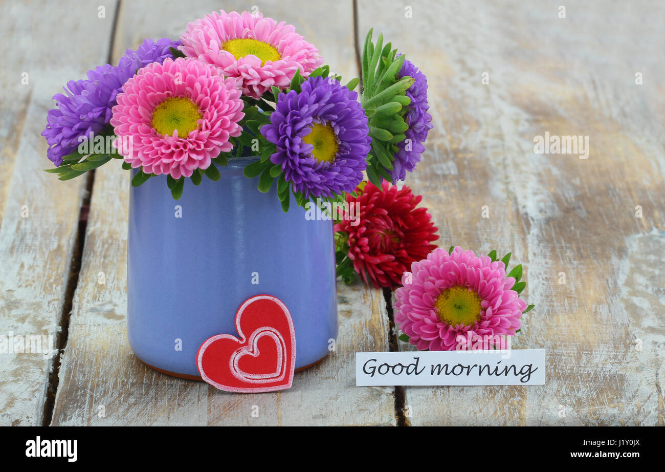 good morning card with colorful daisy flowers in blue vase and red
